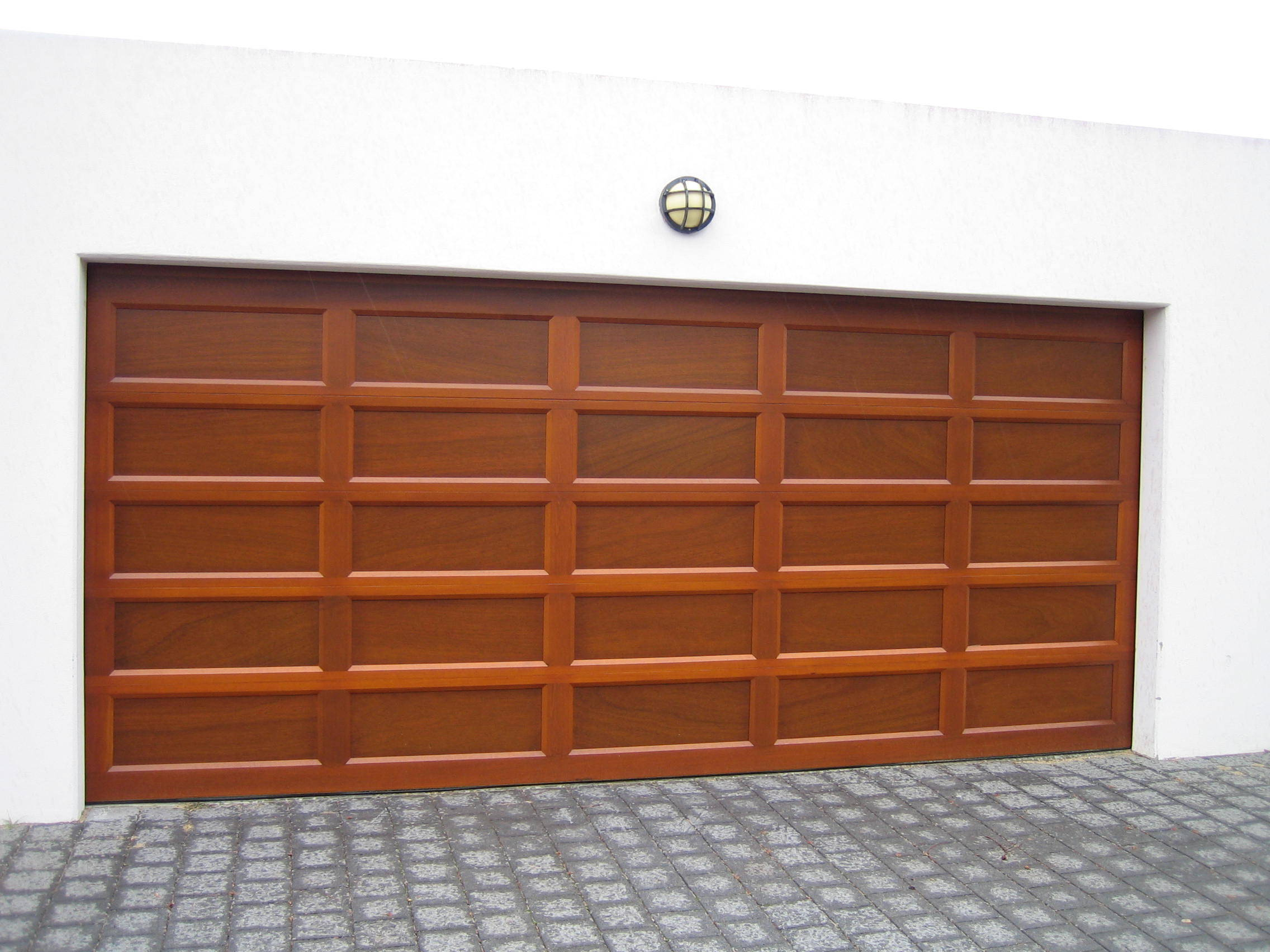 Danmar 39 s recessed panel solid red cedar garage door best for Recessed panel shutters